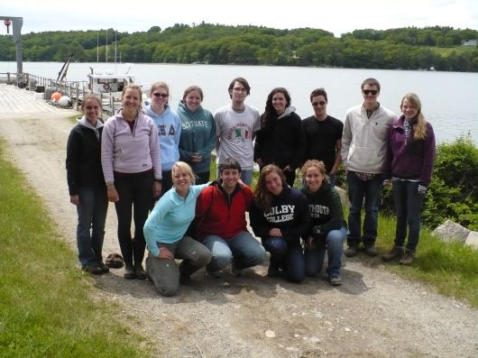 2012 REU students outside. Water in the background.